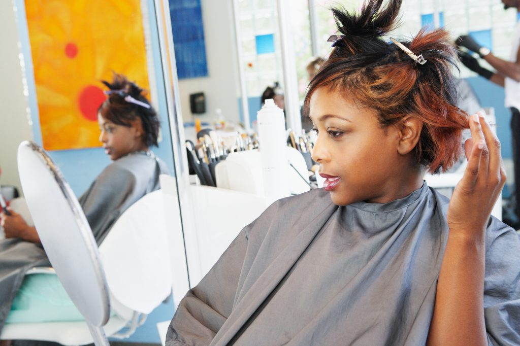 A woman getting her hair done in a salon